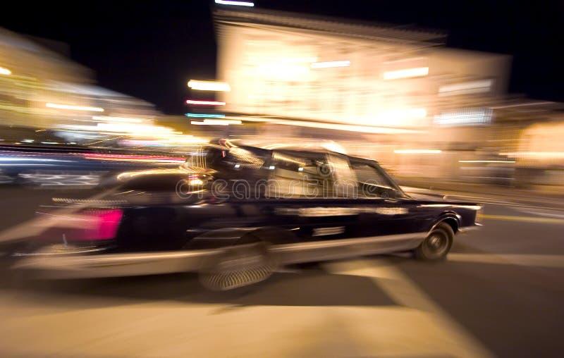疯狂的晚上出租汽车 图库摄影