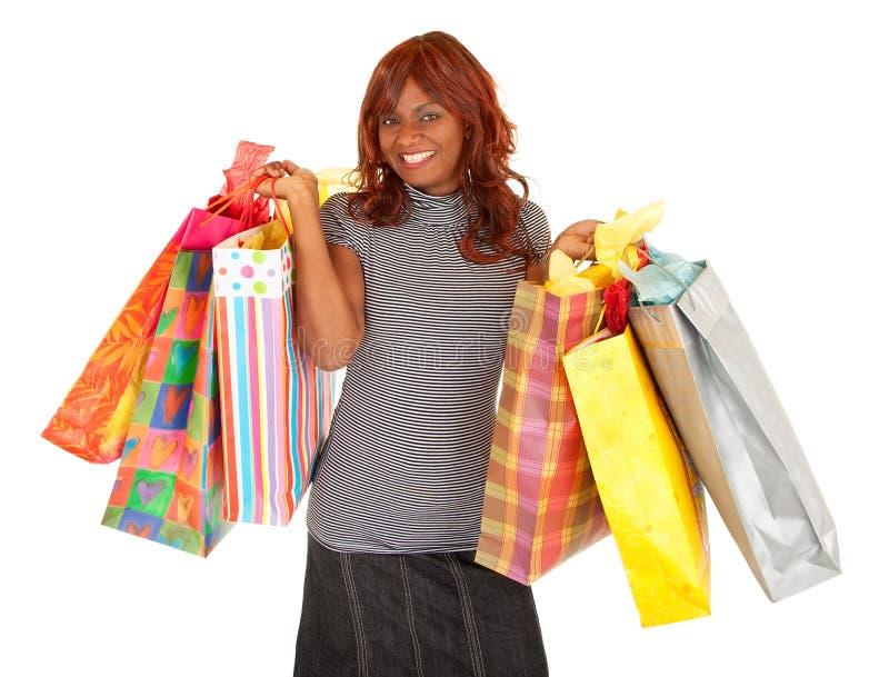 疯狂购物的非洲裔美国人的妇女 免版税库存照片