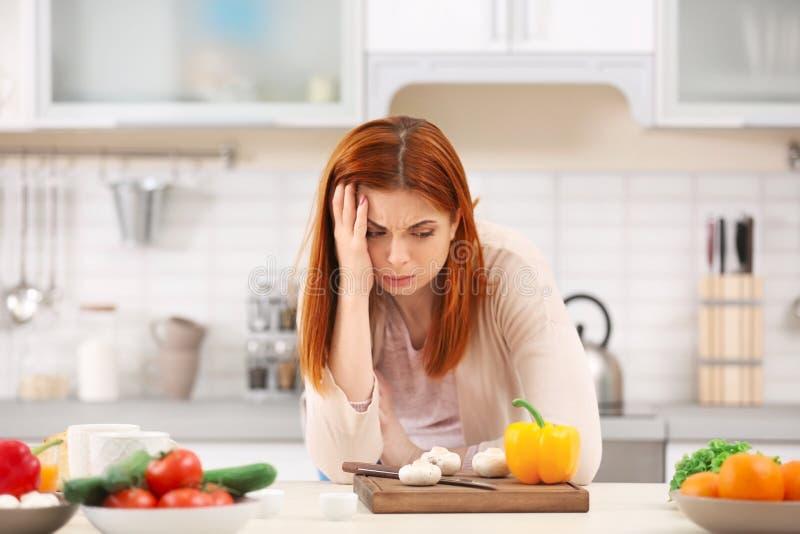 疲乏主妇烹调 免版税库存照片