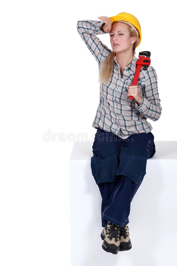 疲乏的女性水管工 库存照片