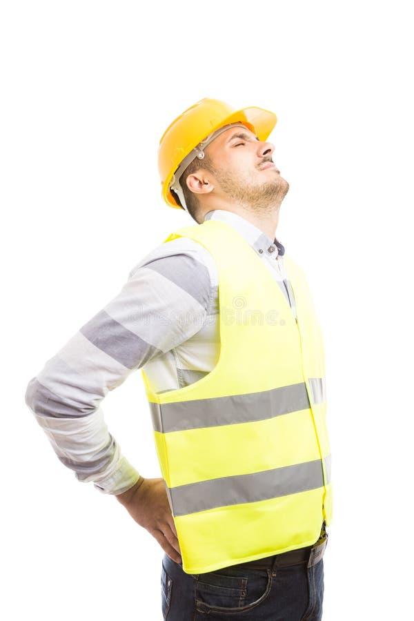 疲乏的工程师或建造者遭受的更加低后的腰部痛苦 库存照片