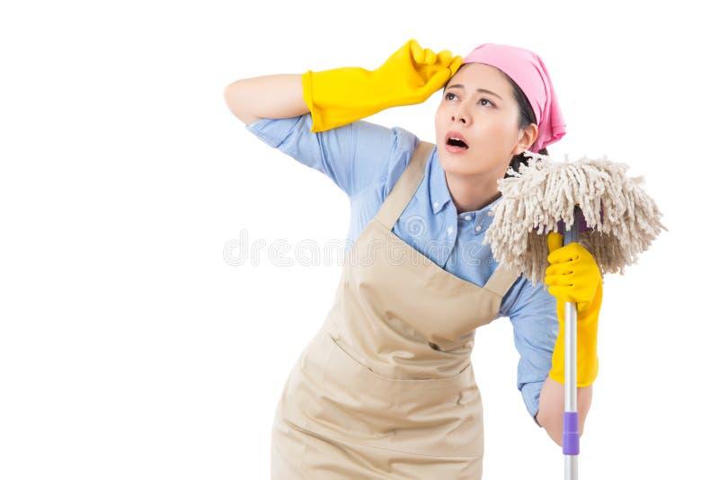 疲倦的和用尽的清洁女仆 免版税库存图片