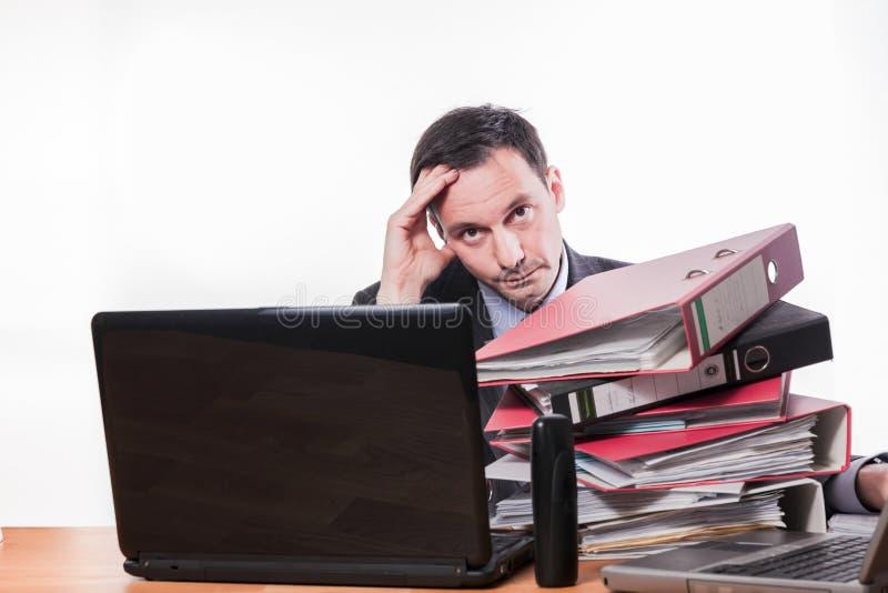 疲倦的和被用尽的雇员许多工作 库存照片