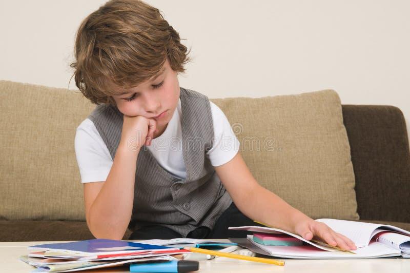 疲倦的家庭作业 免版税库存图片