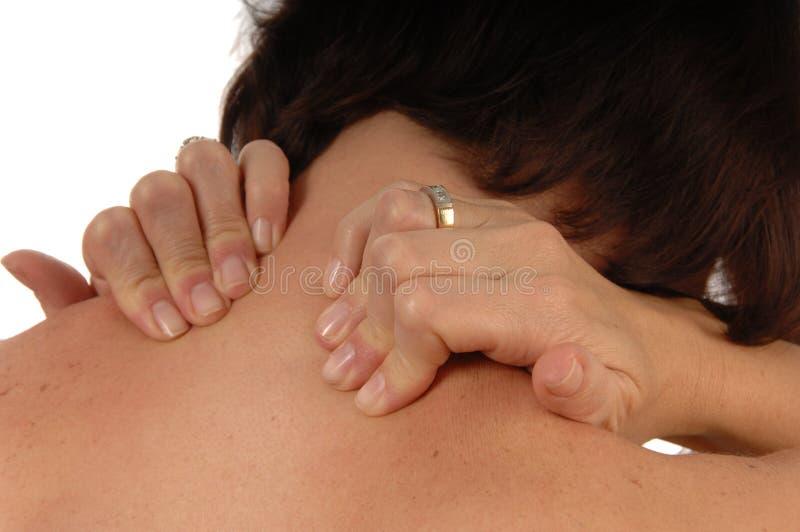 疼痛回到脖子妇女 图库摄影