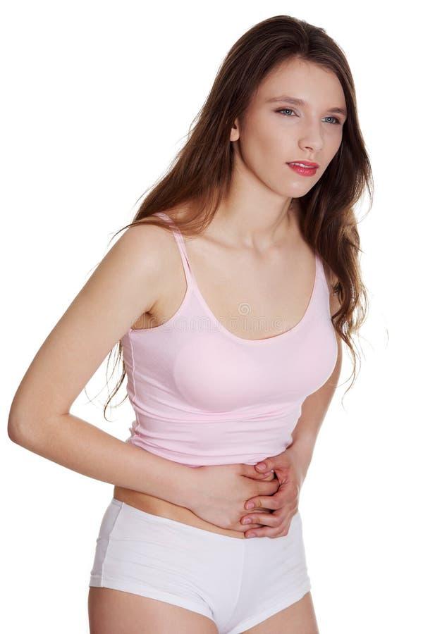 疼痛腹部拉的妇女 免版税库存照片