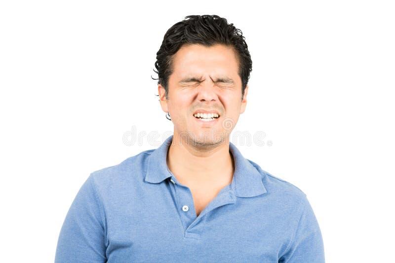痛苦表情西班牙男性做鬼脸 免版税图库摄影