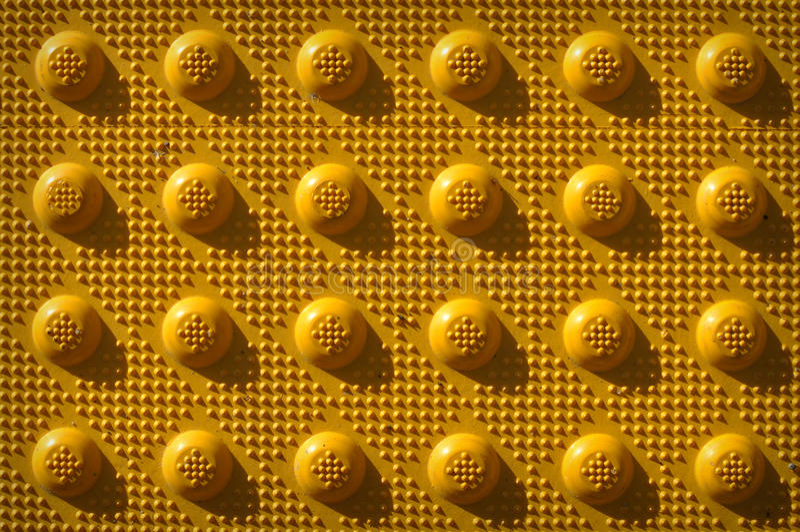 瘤模式重复黄色 库存图片