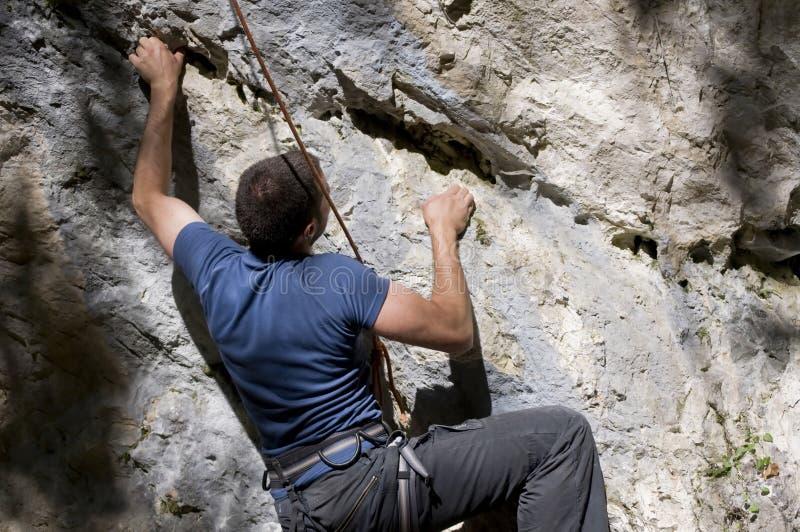 登山人岩石 库存照片