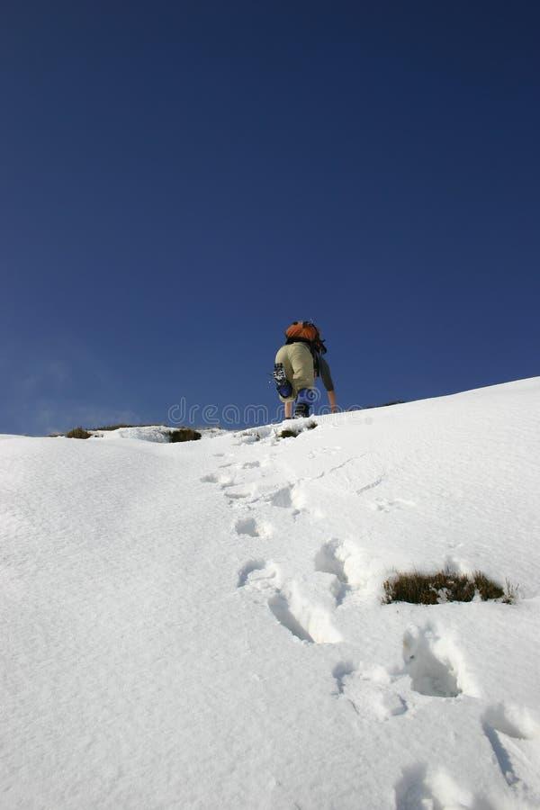 登山人雪 免版税库存照片