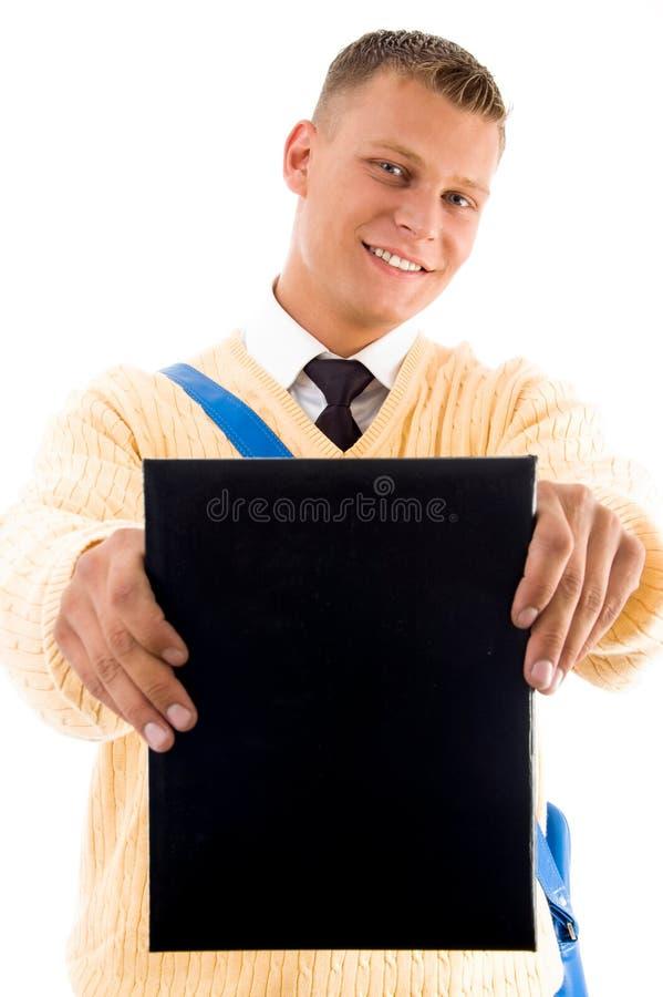 登记他显示的学员年轻人 免版税图库摄影