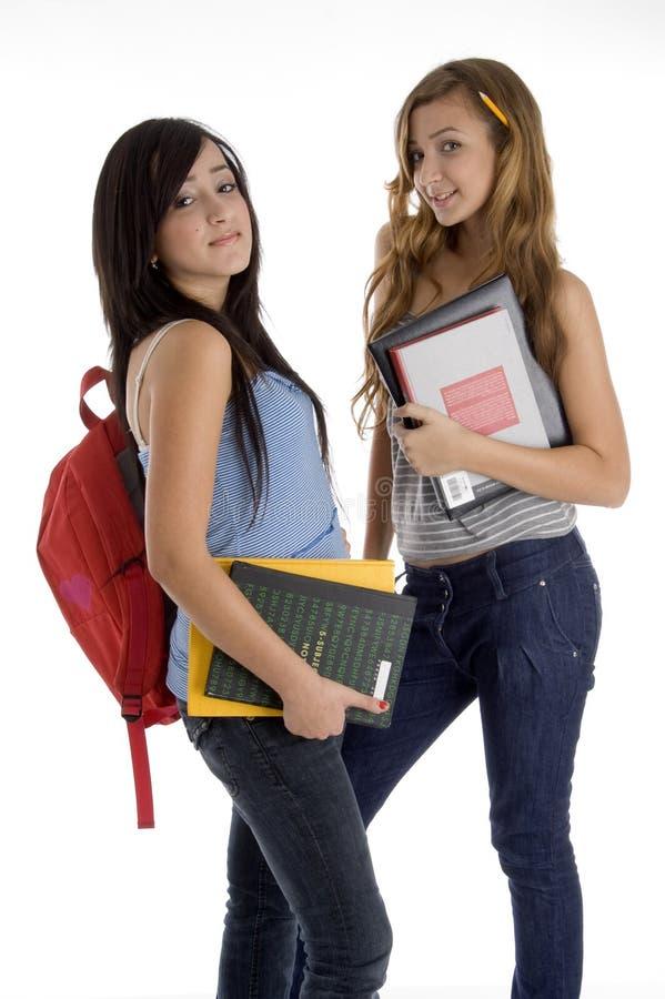 登记拿着学校的女孩一起突出 库存图片