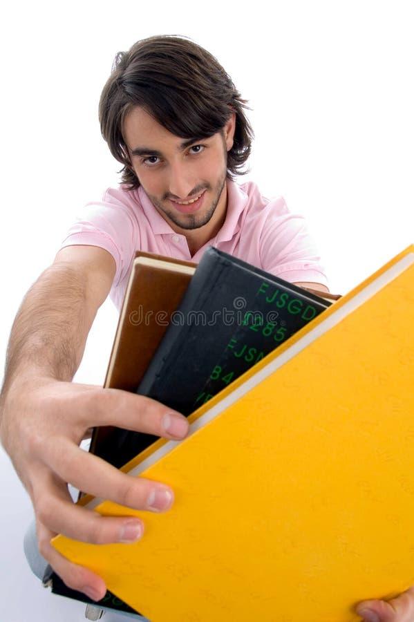 登记显示微笑的男 免版税库存图片