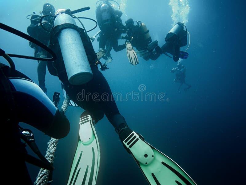 登高对表面的轻潜水员 库存照片