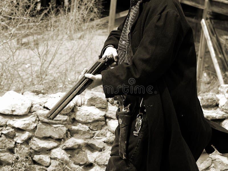 白棉布gunfighter13 免版税库存图片