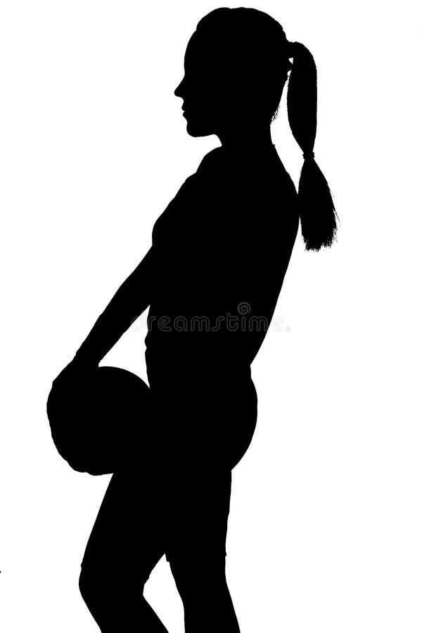 白种人专业排球黑明暗差别强烈剪影  库存图片