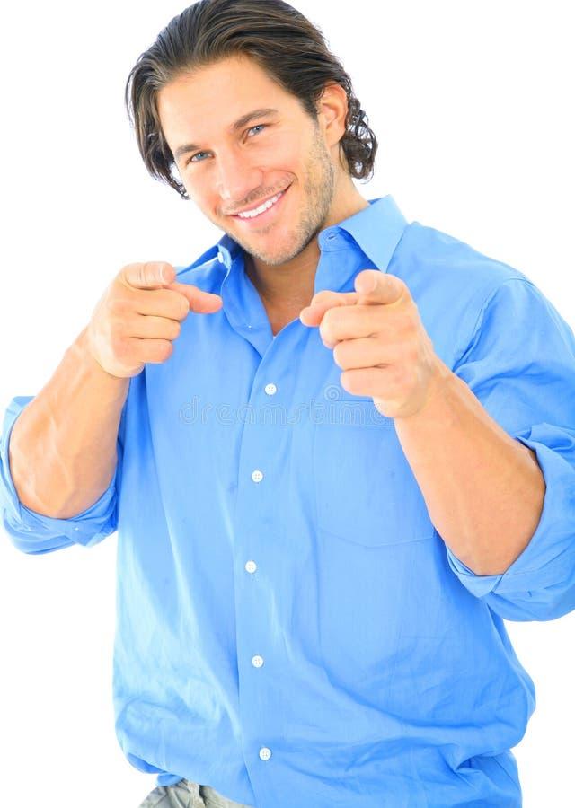 白种人愉快的男性指向的浏览器年轻&# 免版税库存图片