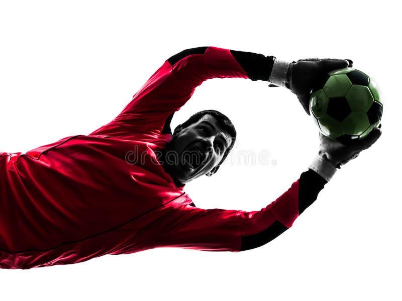 白种人足球运动员守门员人传染性的球剪影 免版税库存照片