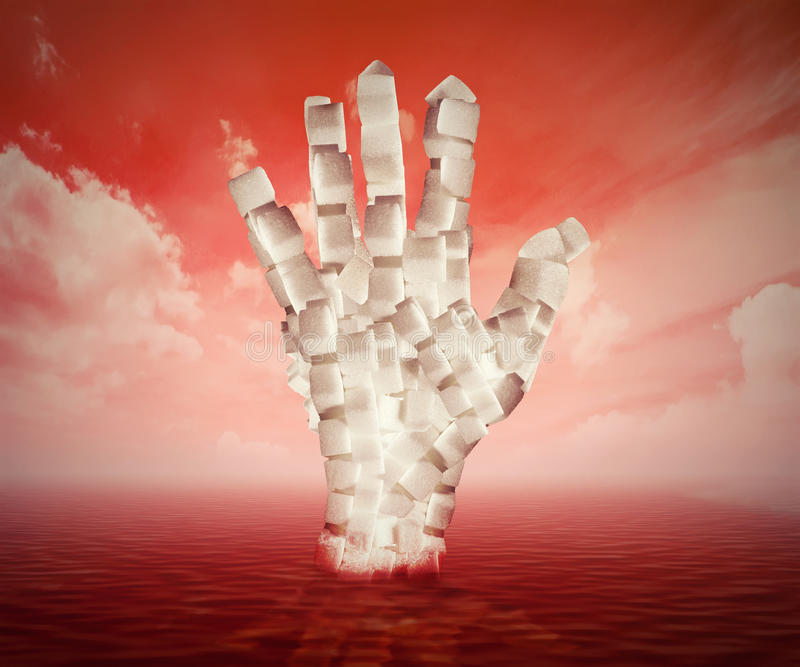 白糖立方体塑造了作为漂浮在血液的人的手 免版税库存图片