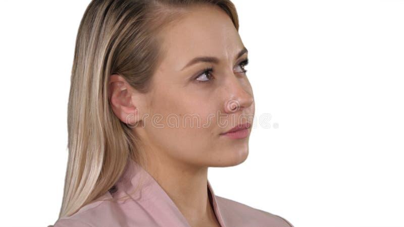 白肤金发有在白色背景的有些想法 库存图片