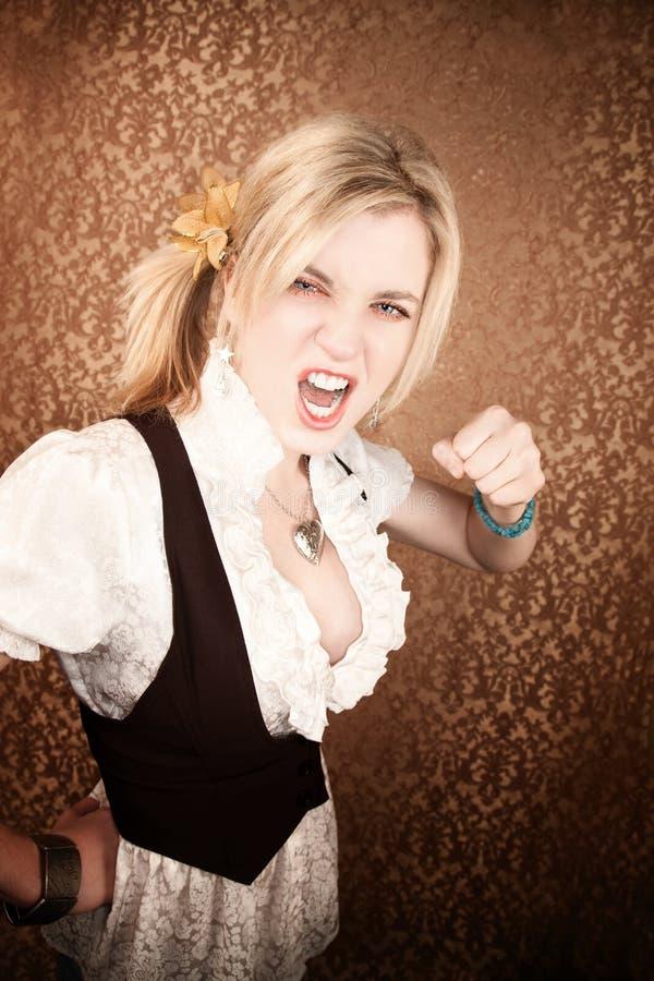 白肤金发的俏丽的打孔机投掷的妇女&# 库存图片