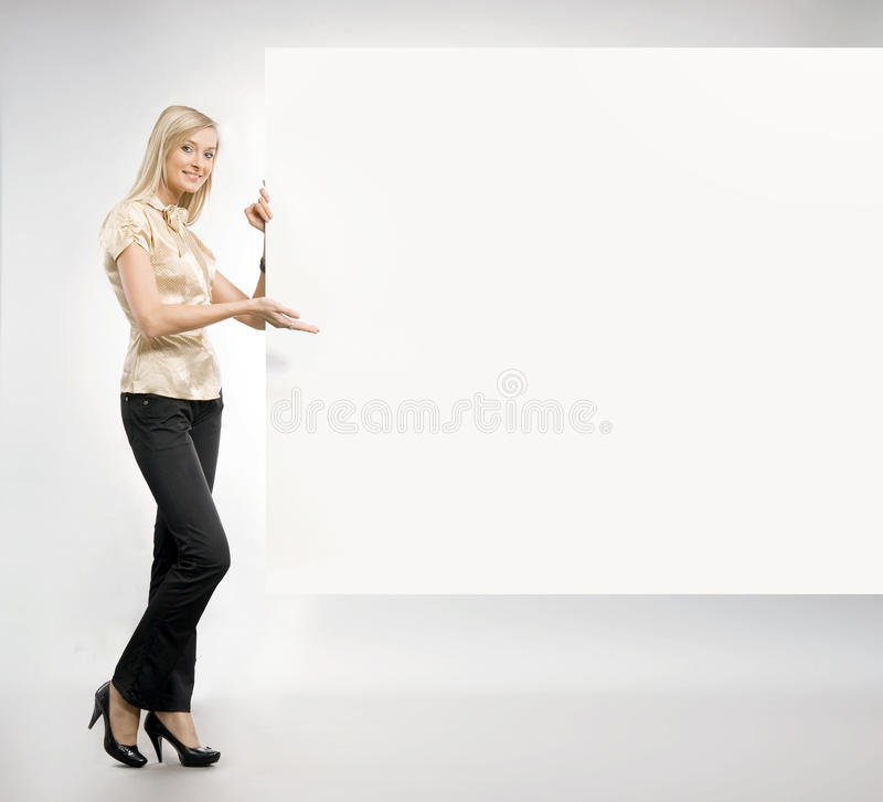 白肤金发的俏丽的秘书 图库摄影