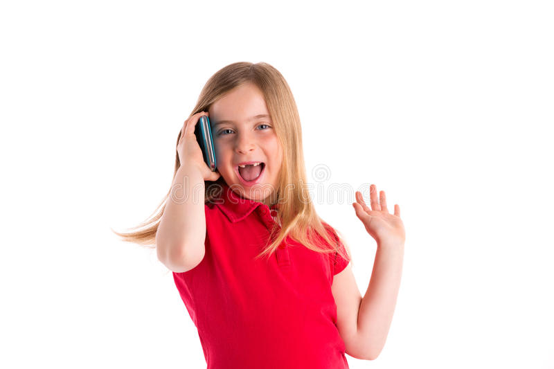 白肤金发的凹进的女孩微笑的谈的智能手机 库存照片