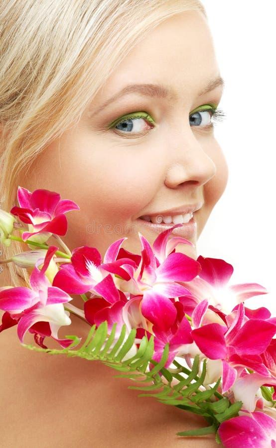 白肤金发的可爱的兰花 免版税图库摄影