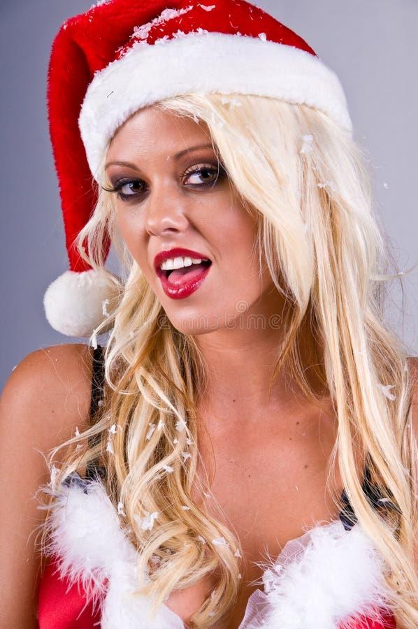 白肤金发的圣诞老人雪妇女 免版税库存照片
