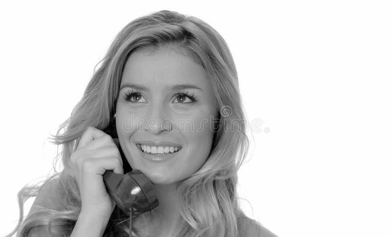 白肤金发的女孩可爱的电话 免版税图库摄影