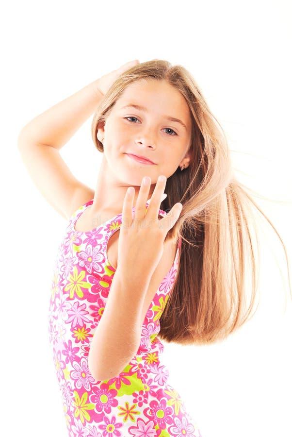 白肤金发的女孩头发长期一点 免版税库存图片