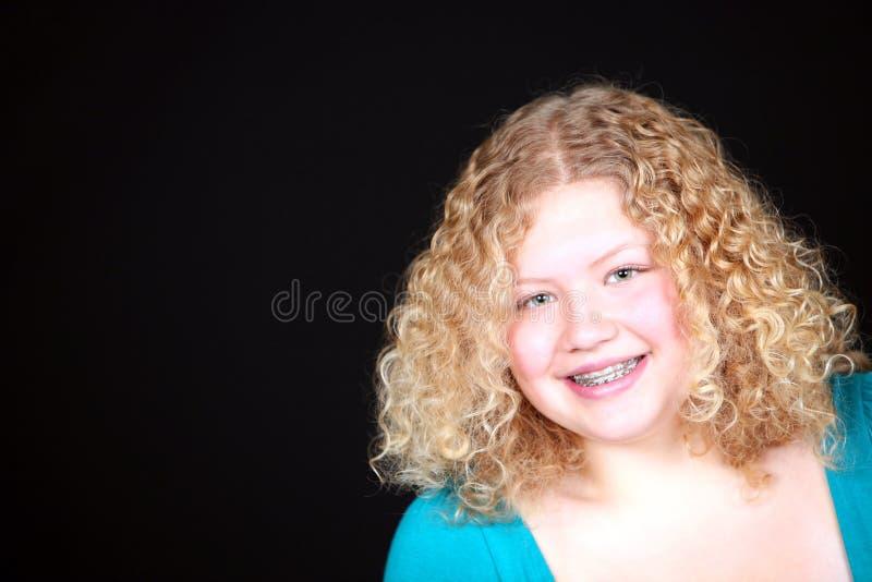 白肤金发的女孩实际微笑 库存照片