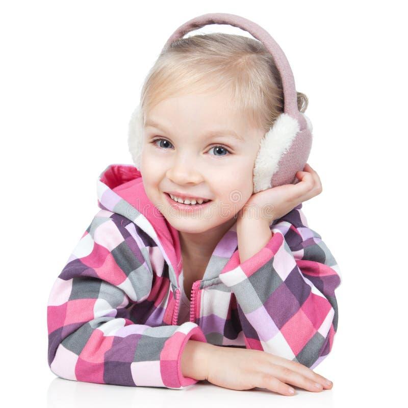 白肤金发的女孩耳机少许空白冬天 库存照片