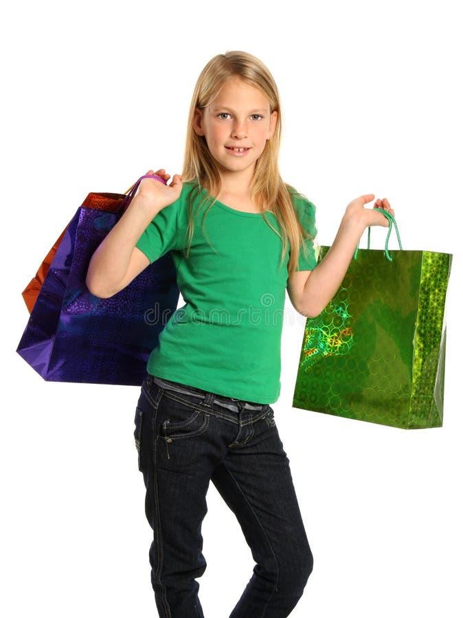 白肤金发的女孩购物年轻人 图库摄影