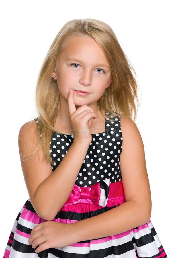 白肤金发的小女孩认为 库存图片