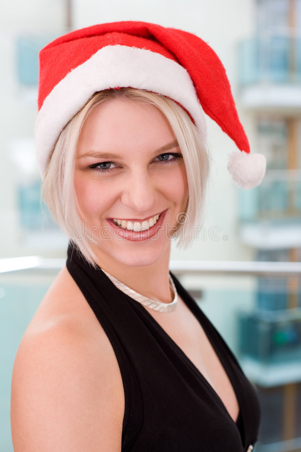 白肤金发的帽子圣诞老人妇女 库存照片