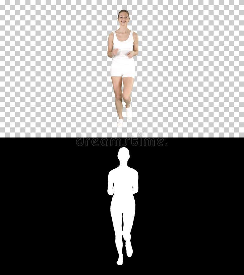 白肤金发的年轻女人赛跑,阿尔法通道 库存图片