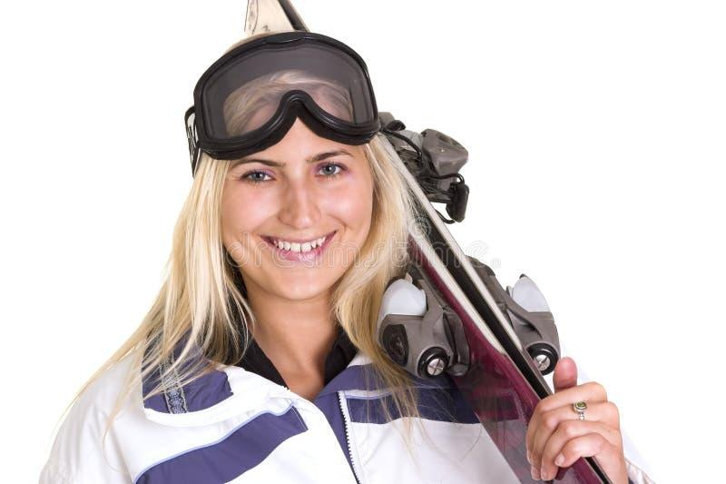 白肤金发的滑雪者妇女 免版税库存图片