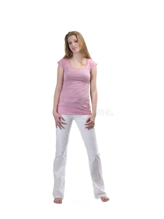 白肤金发的牛仔裤变粉红色青少年的&# 库存照片