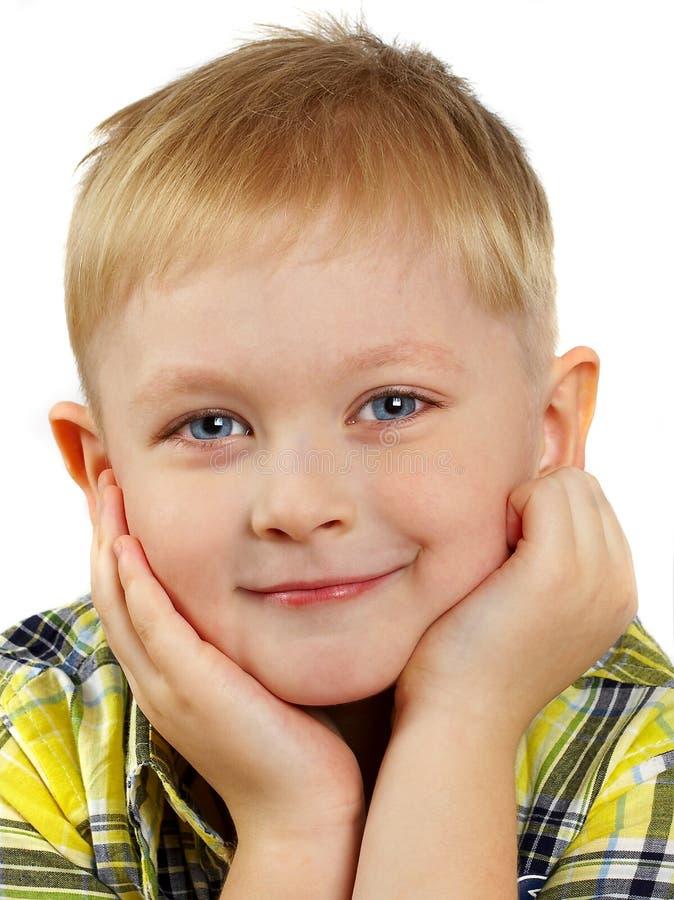 白肤金发的男孩纵向微笑  免版税库存照片
