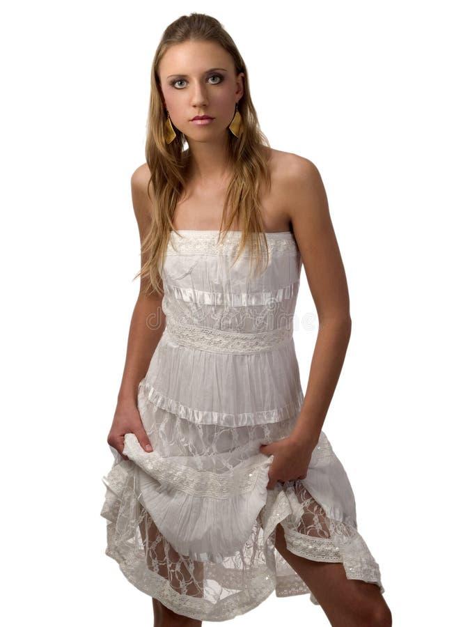 白肤金发的白色服装妇女年轻人 免版税图库摄影