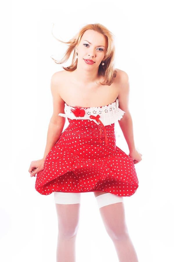 白肤金发的礼服红色 免版税图库摄影