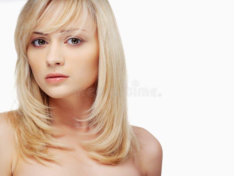 白肤金发的纵向妇女 图库摄影