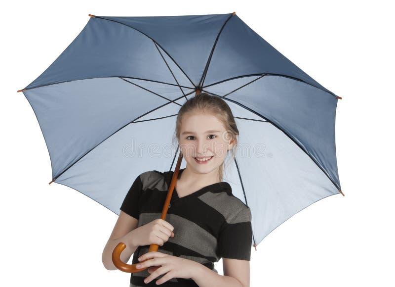 白肤金发的蓝色女孩藏品常设伞 免版税库存图片