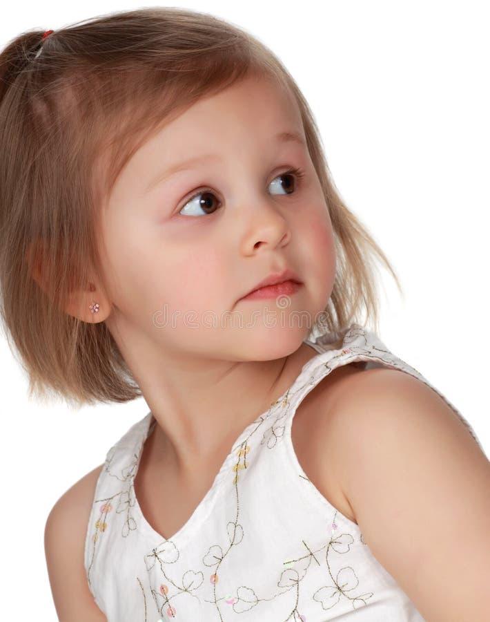 白肤金发的逗人喜爱的女孩一点 免版税库存图片
