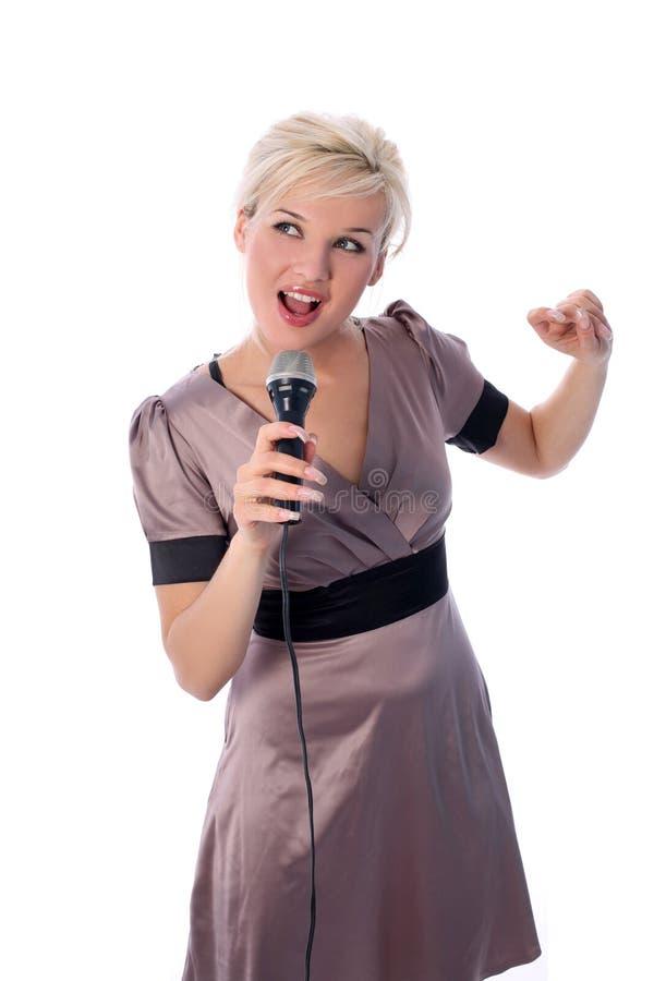 白肤金发的mic 免版税库存照片
