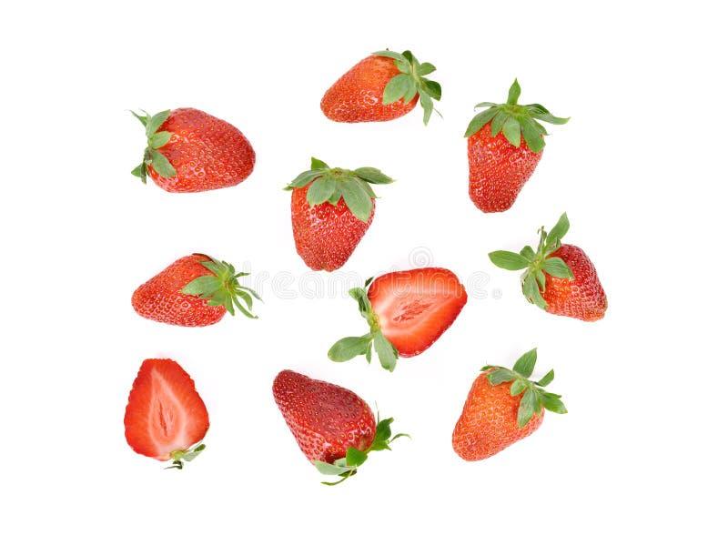 白背景下全切半切鲜熟草莓鸟眼 免版税图库摄影