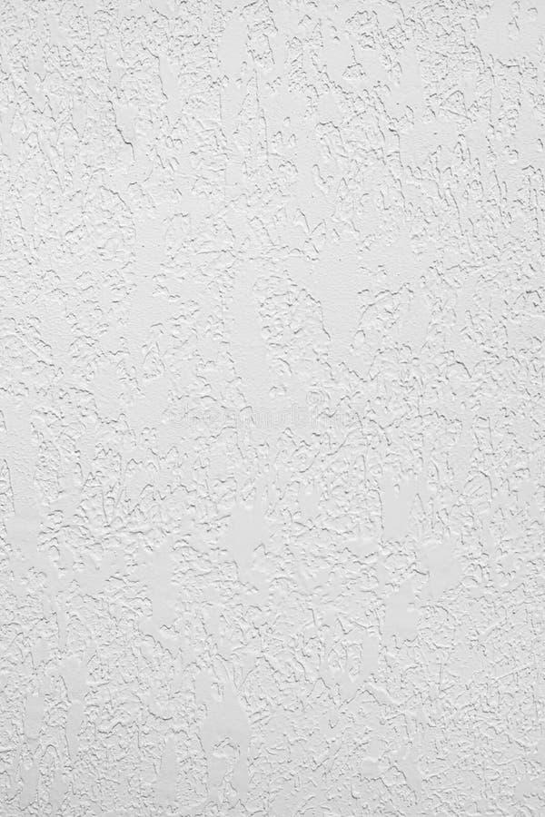 白色上色了低对比具体织地不很细背景以坎坷和不规则性 免版税库存照片