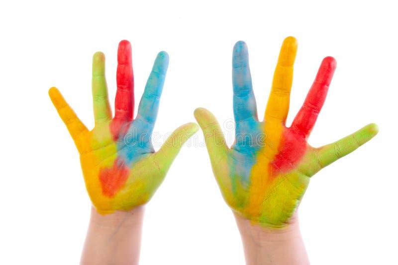 白色上隔离的彩色儿童手 免版税库存照片