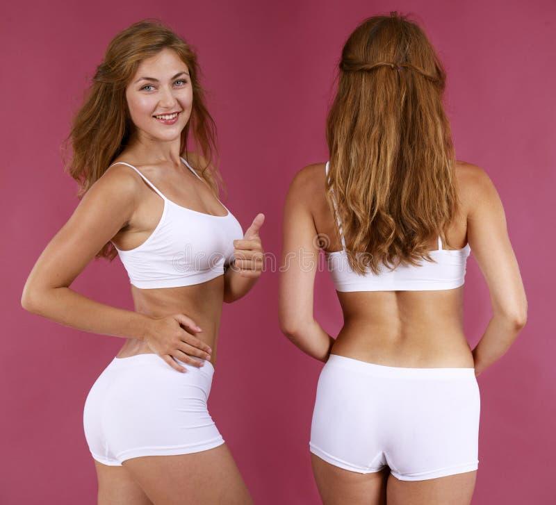 白色健身衣物的年轻美丽的白肤金发的妇女 图库摄影